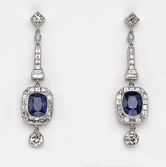 A pair of sapphire and diamond earrings  estimated total sapphire weight for the pair: 6.00 carats; estimated total diamond weight for the pair: 2.65 carats; mounted in eighteen karat white gold