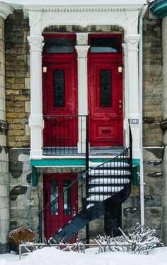 Red doors of a triplex with a spiral staircase on rue Jeanne-Mance in Le Plateau, Montreal shot during winter with snow on the ground. Cool Doors, Unique Doors, Windows And Doors, Red Doors, Montreal Ville, Montreal Quebec, Door Gate, Belle Villa, Portal