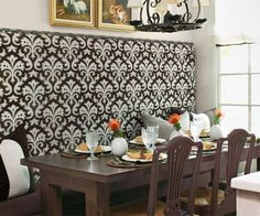 Create a kitchen banquette by repurposing a fabric-covered headboard with nail-head trim. Or custom-build one of your own; to find the how-to, go to thisoldhouse.com/may2014.