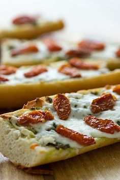 French Bread Pizza With Pesto & Sun-Dried Tomatoes recipe from Oh My Veggies. Ingredients: 1 french demi-baguette, halved lengthwise, c. pesto, c. shredded mozzarella or italian-blend cheese, c. Best Junk Food, Good Food, Yummy Food, Delicious Recipes, Roasted Cherry Tomatoes, Dried Tomatoes, Pizza Recipes, Vegetarian Recipes, Vegetarian Pizza