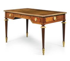 A mahogany and acajou moucheté bureau plat stamped twice J-H. Riesener JME, Louis XVI, circa 1780 Estimate   50,000 — 70,000  GBP