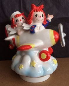 Musical Painted Ceramic Raggedy Ann and Andy Flying High music Box