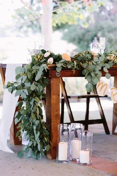 draped eucalyptus table runner, photo by Shane and Lauren Photography http://ruffledblog.com/romantic-wedding-meets-winery-chic #weddingideas #tablerunner