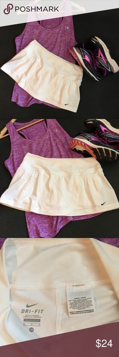 Nike Dri - Fit White Athletic Skort NWOT Nike Dri - Fit White Athletic Skort Golf, Tennis, Running  NWOT  Cover Photo is similar, but not exact match to the one I'm selling. Please reference my photos.  Cute Pleating on both sides in the front. Nike Shorts Skorts