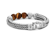 Sterling silver Buddha to Buddha bracelet with tiger eye beads is sure to make you a trendsetter.