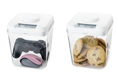 Kitchen Safe - small timed safes. This is really cool to avoid temptation. Good parenting idea too. $40.