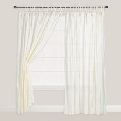 Dreamy, light and airy, our 100% cotton Natural Crinkle Voile Cotton Curtain is wonderfully adaptable to a wide range of decorating styles. Practically speaking, this curtain provides privacy but allows soft, diffused light to enter, while the tie tops create an informal elegance. Use in the bedroom as a soothing accent or hang in multiples around a four - poster bed.