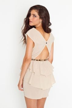 Nude Peplum Dress. looking for a dress to wear to a wedding this coming weekend? I love the back:)