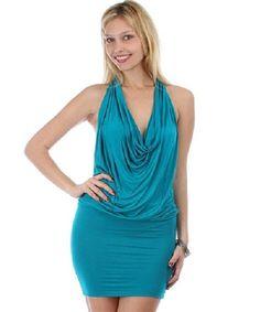 Description Teal draped halter dress with fitted bottom half and leopard sequin split back divider. 80% Cotton 10% Polyester 10% Spandex