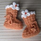 Orange Booties with Cream Flowers - via @Craftsy