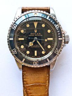 vintage Rolex SubMariner w/ leather band