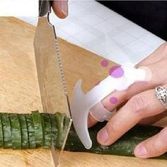 A worried face that will protect your fingers from hurried chopping. | 31 Borderline Genius Kitchen Products That Will Help You Survive Holiday Cooking