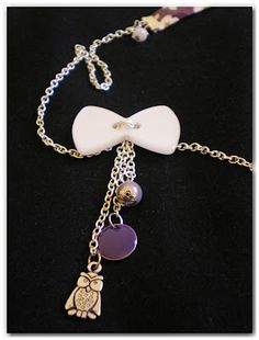 Sautoir liberty violet et bouton noeud blanc