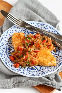 This baked crispy chicken is topped with a fantastic sweet and savory mix of caramelized onions, tomatoes and herbs. 289 calories and 6 Weight Watchers SmartPoints