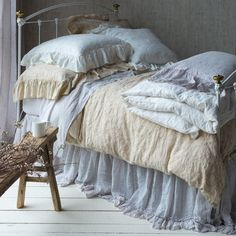 """Pinning around a box spring's edge with an extended 3"""" header above its drop, this unique bedding accessory boasts the appearance of a typical bed skirt through"""