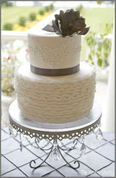 Vintage Gray and White Wedding Cake with Ruffles by The Pastry Studio.