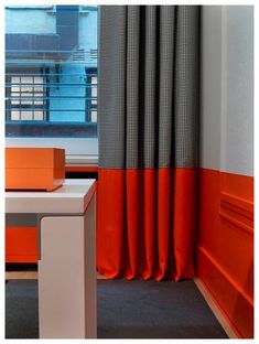 Bright bold color stripe along bottom of wall same/contrasting color to that painting all tools and paintable furniture.