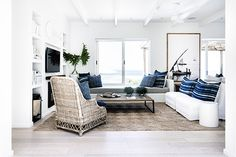 High on the mountainside overlooking Plettenberg Bay lagoon, Indigo House commands a spectacular view and boasts signature indigo, white and wood interiors. Lifestyle Trends, Wood Interiors, Rental Property, Hygge, Entryway Bench, Beach House, Indigo, Things To Come, Couch