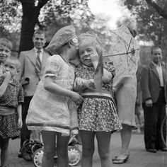 "The liberation of Holland in 1945 at the end of World War II. The caption reads: ""Little girls in (their) 'liberation outfits'"""