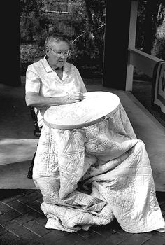 Woman quilting by hand.