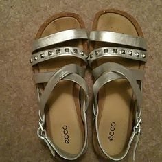Ecco silver studded sandals size 36 (5-6) These comfy sandals, for which ecco are known, are terrif -- they're simply way too wide for me. Online purchase with no return. Tried to wear two times. Studs are amazing; leather is soft. Comfort all around. Run big for a 36 so should fit a 6 or 6.5. Ecco Shoes Sandals