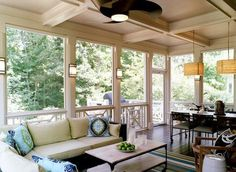 Love that within the screened porch there's a seating area as well as a dining area. Lots of lighting too plus fan. Then a deck outside. Could go down to a patio even.