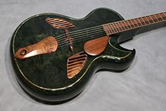 Taku Sakashta, the maker of this guitar among many other innovative and beautiful creations, was brutally murdered  in 2010. A tragic loss.
