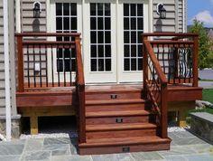 Image from http://www.ozcorpfinebuilders.com/services/decks/images/ipe-deck-bluestone-patio/7.JPG.