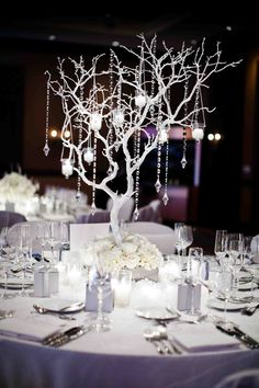 White tree branch centerpiece with crystals                                                                                                                                                                                 More