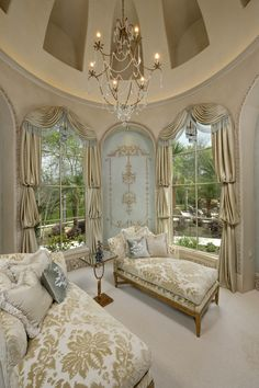 A tall dome ceiling with arched niches, decorative onlays on faux textured walls and large windows create a relaxing space to curl up and read a book.
