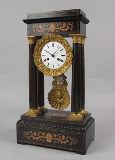 An original large antique rosewood inlayed French portico clock circa:1870 With original fully serviced movement and original unusual pendulum in working order, striking on a bell every half hour, running for a week. Whole over in good original condition and patination. Fine cast work the pillars and around the dial. This portico clock is about 4 cm higher than a normal portico clock also a few cm wider and deeper, it has a powerful appearance. With key. Dimensions: 50 cm high, 27cm wide…