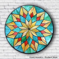Student Work by Lynn created in a Kasia Mosaics Stained Glass Mosaic Flower Mandala Workshop. Sign up for an Online Class, an All Level Studio Class or purchase project kits via www.kasiamosaics.com