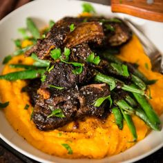Nothing's as satisfying as perfectly braised short ribs. They melt under your fork and bring nothing but flavor and with this easy slow cooker recipe, you can recreate thisrestaurant quality meal at home. Braised Short Ribs over Sweet Potato Puree Recipe Am I the only sucker who didn't know the joy of a short rib …