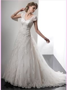 White A Line Beading Lace Wedding Dress...  If this was just a little fuller...this would pretty much be it...