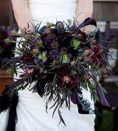 A unique dark-tone bride's bouquet by Sophisticated Floral Designs from Portland, Oregon! We're seeing Agonis, calla lily, succulents, cymbidium orchids, fiddlehead fern curls and eucalyptus Photo...