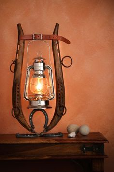Horse Hames and Horse Shoes Oil Lantern by FitzMunozStudio on Etsy - This lamp will be a great touch of rustic country style in your home, ranch or cabin. Not to mention the romantic and warm feeling of a low light creating a relaxing environment. Horseshoe Crafts, Horseshoe Art, Country Decor, Rustic Decor, Primitive Decor, Country Style, Western Crafts, Equestrian Decor, Light Design
