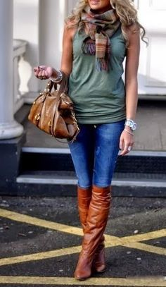 Sleeveless blouse, jeans, long leather boots and scarf fashion for fall