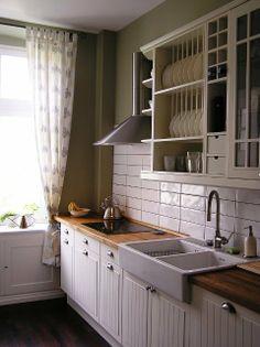 ikea sink, subway tile, butcher block counters, oven hood, sink faucet