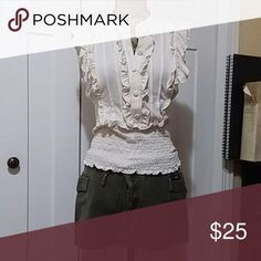 White sleeveless top with green shorts White sleeveless top is a larger with green shorts with three buttons and tie string on the belt size small Tops Tank Tops