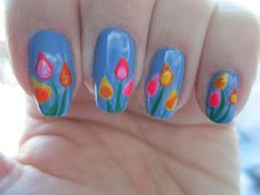 China Glaze Electric Beat for the base color. The tulips were made using: China Glaze Dance Baby, CG Pool Party, CG Japanese Koi, CG Solar Power, CG Papaya Punch, CG Sun Worshiper, and CG Shocking Pink. The stems were made with Stripe Rite It's So Easy in Green. Solar Nails, Easter Nail Art, Japanese Koi, Tough As Nails, Finger Nails, China Glaze, Spring Nails, Stems, Solar Power