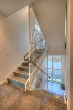 Sustainable Design Thomas Eco House By Designs Northwest Architects Perforated Metal Panel, Metal Panels, Seattle, Metal Grill, Nachhaltiges Design, Design Ideas, Tile Stairs, Stair Detail, Modern Staircase