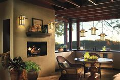 Year round outdoor living with this covered patio and fireplace