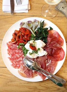 Antipasti with Buffalo Mozzarella, marinated Artichokes, prosciutto di Parma and more.