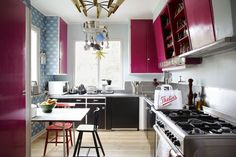 I never would've thought of it, but the fuschia is nice.  Cute little kitchen.