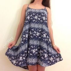"""⚡️FLASH SALE⚡️Blue Floral Gaby Dress Rare print, great condition. I'm 5""""1 for reference.   •NO TRADES EVER •NO OFFERS DURING FLASH SALES •If you have a problem about my price and decide to throw in your opinion on my post, I won't hesitate to block you.  •I sell on Mercari for cheaper! Brandy Melville Dresses Mini"""