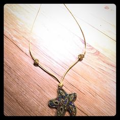 STARFISH GEM PENDANT NECKLACE Gold leather rope, goldtone starfish with various colored gems. Jewelry Necklaces