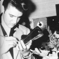 Signing a fans shoe - Elvis never left