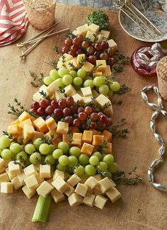 Christmas Tree Cheese Board - Thinking it could be made into bell shapes for New Year's - ringing in the new year?? Red grapes/cherry tomatoes worked into a heart for V'day?