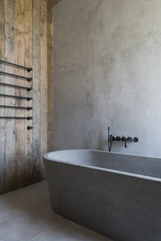 Rustic minimalism at its finest in this Arte Povera-inspired penthouse. Designer Vincent Van Duysen seamlessly integrates cement, reclaimed wood, and black metal fixtures into a cohesive — not to mention ultra-chic and relaxing — commode. Industrial Bathroom, Rustic Bathrooms, Wood Bathroom, Grey Bathrooms, Bathroom Colors, Bathroom Sets, Small Bathroom, Bathroom Fixtures, Arquitetura