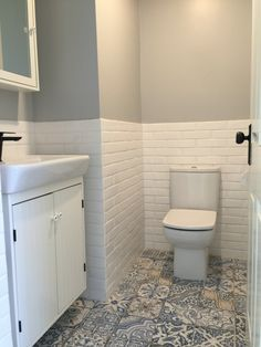 Powder Room Tiles. Vanity & Mirror from Ikea, tiles and tapware from Sydney. Dulux Tranquil Retreat paint